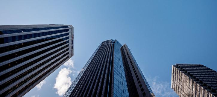 Low angle view of tall office buildings and blue sky in downtown San Francisco