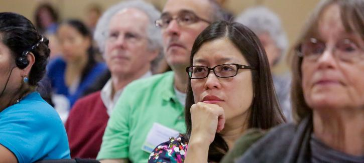Attendees at the special forum listen to the presentation.