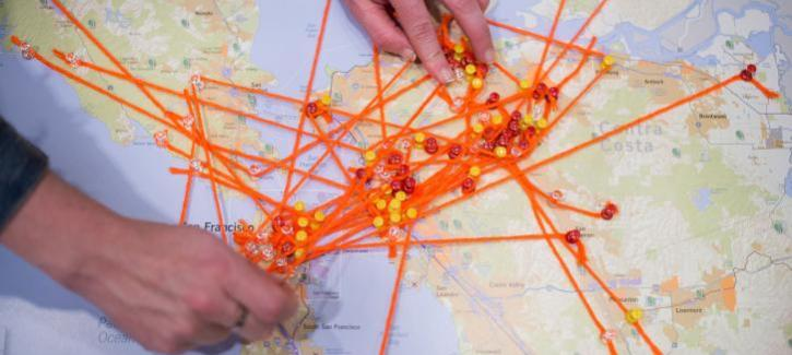 A Bay Area map with orange yarn, mapping residents work, home and leisure locations.